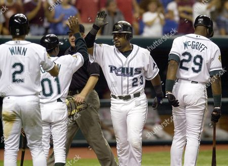 VAUGHN Tampa Bay Devil Rays' Greg Vaughn, center, is congratulated by teammates after hitting a three-run home run against the Philadelphia Phillies in the eighth innning, in St. Petersburg, Fla. The Devil Rays defeated the Phillies 5-3