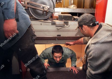 SISGOLD GRUBER Jesse Sisgold, 24, a law student, is helped out of an elevator that is stuck between floors, by Dan Gruber, right, at the University of California Hastings College of the Law in San Francisco, during a rolling blackout, . Pushed over the brink by its botched experiment with deregulation, California cut off power to hundreds of thousands of people Wednesday in the first rolling blackouts imposed during its electricity crisis