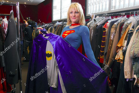 A Bonhams member of staff wears an outfit worn by actress Helen Slater in the 1984 film Supergirl with an estimate of £800-£1,000. She is holding a Batman outfit worn by a David Jason (Del Boy) in the BBC comedy Only Fools And Horses