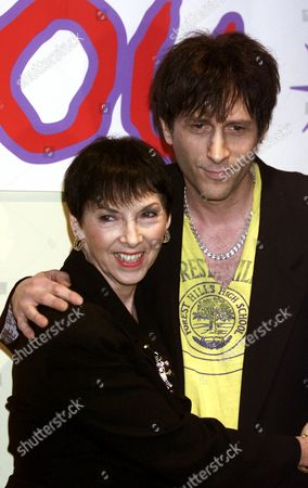 """Stock Image of LESHER LEIGH Charlotte Lesher and Mickey Leigh, the mother and brother of punk rock idol Joey Ramone, appear together for the media before a tribute titled """"Life's A Gas - Joey Ramone's Birthday Bash,"""" in New York, . The leather-jacketed rocker, who helped turn nightclubs like CBGB into rock 'n' roll landmarks, was battling cancer in a Manhattan hospital this year as he made plans with his family to celebrate his upcoming 50th birthday, but he died one month before the party"""