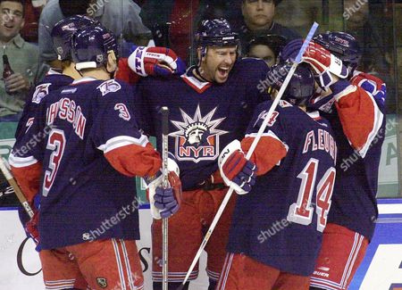 NEDVED New York Rangers center Peter Nedved, middle, celebrates his goal with teammates, including Kim Johnsson (3) and Theo Fleury (14), during the first period against the Tampa Bay Lightning, at the Ice Palace in Tampa, Fla
