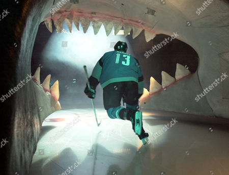 HARVEY San Jose Sharks right wing Todd Harvey skates out of a giant shark's head during introductions before the Sharks game against the Detroit Red Wings, in San Jose, Calif