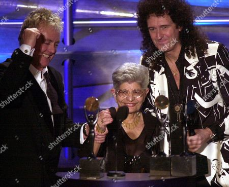 Stock Picture of TAYLOR BULSARA MAY Queen drummer Roger Taylor, left, and guitarist Brian May, flank Jer Bulsara, the mother of the group's most prominent missing member, the late Freddie Mercury, as the group is inducted into the Rock and Roll Hall of Fame at the 16th annual induction dinner, in New York. Mercury died of AIDS in 1991