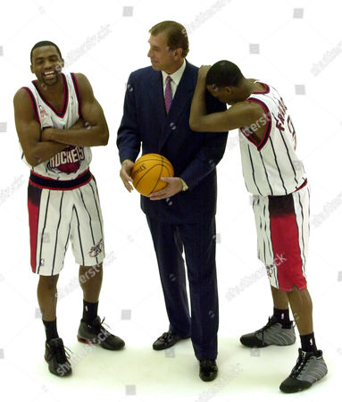 MOBLEY FRANCIS TOMJANOVICH Houston Rockets' Cuttino Mobley, left, and Steve Francis, right, laugh as they are joined by coach Rudy Tomjanovich while posing for a photograph during media day, in Houston