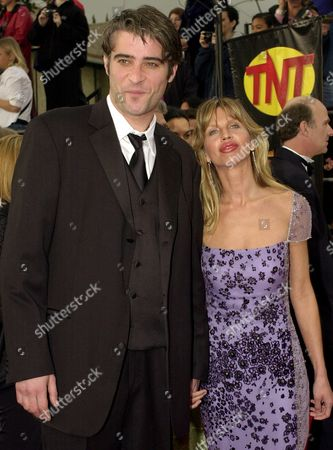 "VISNJIC Actor Goran Visnjic, of television's ""ER,"" arrives with his wife Ivana Vrdoljak at the 7th annual Screen Actors Guild Awards, in Los Angeles"