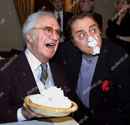 SALES COOPER Comedian Soupy Sales, left, mugs for photographers after delivering his trademark pie-in-the-face to fellow comedian Pat Cooper during a party honoring his 75th birthday, at the Friar's Club in New York