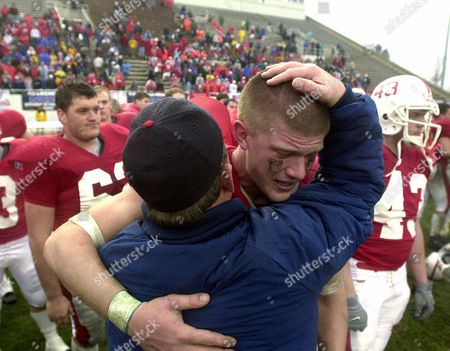 BEYER Saint John's of Minnesota's Brad Beyer is consoled by a supporter after his team lost to Mount Union 10-7 in the NCAA Division III national championship Amos Alonzo Stagg Bowl in Salem, Va