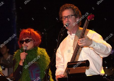 "TAN PEARSON Amy Tan, left, and Ridley Pearson perform with their band ""Rock Bottom Remainders"", in Denver, Colo. The group, which consists of famous authors led by Stephen King, is offering the proceeds from their show to Denver Scores, a non-profit after school program that provides writing and soccer instruction to public elementary school students"