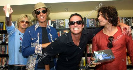 """STONE TEMPLE PILOTS Members of the alternative rock band Stone Temple Pilots pose for photographers at a record store in New York . The band was on hand to promote the release of their new CD, """"Shangri-La-Dee-Da."""" Shown from left are: Eric Kretz, Robert DeLeo, lead singer Scott Weiland and Robert's brother Dean DeLeo. Stone Temple Pilots begin the first leg of their European tour this August, and have a U.S. tour date scheduled for October"""