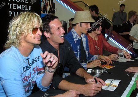 """KRETZ WEILAND DELEO Members of the alternative rock band Stone Temple Pilots sign CD liners for their fans at a record store in New York, . The band was on hand to promote the release of their new CD, """"Shangri-La-De-Da."""" Seated from left are Eric Kretz, Scott Weiland, and brothers Robert and Dean DeLeo"""