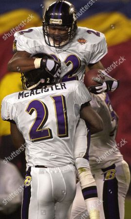 Duane Starks; Chris McAlister Baltimore Ravens defensive back Duane Starks (22) is hoisted by teammate Chris McAlister (21) after Starks scored on a 49-yard interception against the New York Giants in the third quarter of Super Bowl XXXV, in Tampa, Fla. Starks' score was the first of three touchdowns in three consecutive plays. On the following kickoff the Giants Ron Dixon returned the ball 97 yards for New York's only score. The Ravens responded with an 84-yard Jermaine Lewis kickoff return of their own. The Ravens dominated this game 34-7