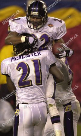 STARKS MCALISTER Baltimore Ravens defensive back Duane Starks (22) is hoisted by teammate Chris McAlister (21) after Starks scored on a 49-yard interception in the third quarter at Raymond James Stadium during Super Bowl XXXV in Tampa, Fla