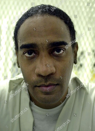 MITCHELL FILE--Convicted killer Gerald Mitchell stares out from a cell in the visitors area of death row in Livingston, Texas, . Mitchell is scheduled to be executed at the Texas prison in Huntsville Monday, Oct. 22, 2001. Mitchell, 33, was condemned for a murder he committed at the age of 17. Mitchell was convicted of killing Charles Anthony Marino, 20. Marino was fatally shot with a sawed-off shotgun after he and his brother-in-law, Kenneth Fleming, tried to buy $1 worth of marijuanafrom Mitchell in Houston, court records show