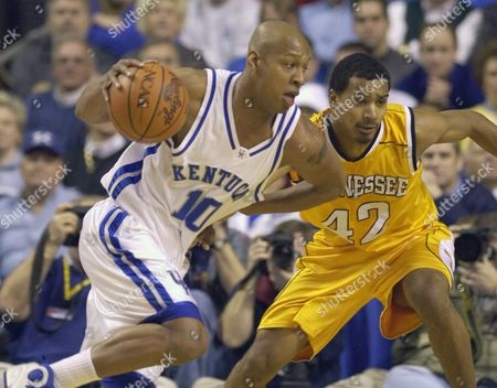 BOGANS HIGGINS Kentucky's Keith Bogans looks for room as he drives past Tennessee's Jon Higgins during the first half of their game Tuesday night, in Lexington, Ky