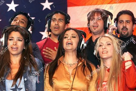 "GOODBYE Pilar Montenegro, left, Lucia Mendez, center, and Yuri, right, rehearse before an all-star group of Latin musical artists recorded the song ""El Ultimo Adios,"" (The Last Goodbye), at The Hit Factory studios in Miami. The proceeds from the sale of the song will be donated to the American Red Cross and the United Way"