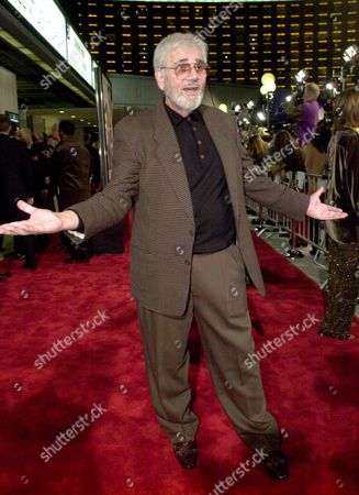 """ROCCO Alex Rocco chats with photographers before the premiere of """"The Wedding Planner,"""", in the Century City area of Los Angeles. Rocco is a part of a cast that includes Matthew McConaughey, Jennifer Lopez, Bridgette Wilson-Sampras, and Justin Chambers in the romantic comedy"""