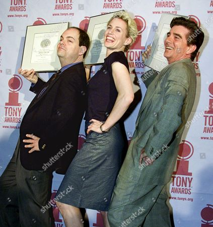 """OSCAR HUFFMAN BEACH Brad Oscar, left, Cady Huffman, and Gary Beach, from Mel Brooks's """"The Producers,"""" strike a pose as they show off their nomination certificates at the 2001 Tony Awards brunch in New York . Oscar and Beach are nominated for Best Performance by a Featured Actor in a Musical and Huffman for Featured Actress in a Musical"""