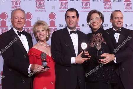 """GROVE The production team of the play """"Proof,"""" from left, Peter Solomon, Daryl Roth, playwright David Auburn, Lynne Meadow and Barry Grove pose with his Tony award for Best Play at the 55th annual Tony Awards ceremonies in New York. Auburn also won the 2001 Pulizer Prize for the play"""