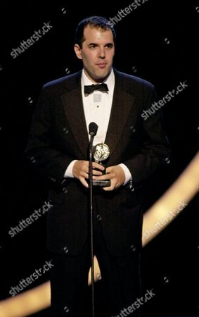 """AUBURN David Auburn, author of """"Proof,"""" accepts the award for best play during the 55th annual Tony Awards, at New York's Radio City Music Hall"""