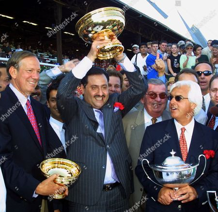 GIVEN Point Given's owner Prince Ahmed bin Salman, center, hoists the Travers Cup above his head in celebration as New York Gov. George E. Pataki, left, and trainer Bob Baffert look, at Saratoga Race Course, Saratoga Springs, N.Y. Point Given captured the 132nd running of the Travers Stakes