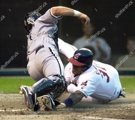 CORDERO JOHNSON Cleveland Indians runner Wilfredo Cordero is tagged out by Chicago White Sox catcher Mark Johnson in the fifth inning, at Jacobs Field in Cleveland