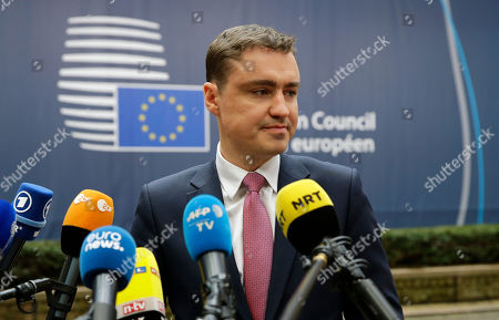 Estonian Prime Minister Taavi Roivas speaks to media reporters as he arrives for the EU summit in Brussels, . British Prime Minister Theresa May will hold her first talks with European Union leaders and tell them that the U.K.'s decision to leave the bloc is irreversible