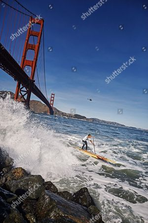 Kai Lenny of the United States competes in the Red Bull Heavy Water Stand Up Paddleboard Race in San Francisco