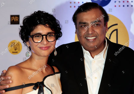 Indian film producer Kiran Rao with chairman and managing director of Reliance Industries Limited Mukesh Ambani pose for photographers during the photo call of the opining ceremony of MAMI 18th Mumbai film festival in Mumbai, India, . The eight day long festival will screen 175 films, including features, documentaries and short films from 54 countries