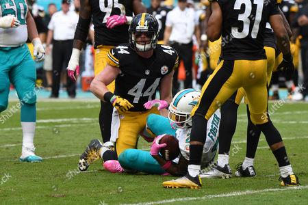 Tyler Matakevich #44 of Pittsburgh tackles Arian Foster #29 of Miami during the NFL football game between the Miami Dolphins and Pittsburgh Steelers at Sun Life Stadium in Miami Gardens FL. The Dolphins defeated the Steelers 30-15