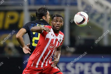 Inter Milan's Citadin Martins Eder, left, challenges for the ball with Southampton's Cuco Martina during the Europa League group K soccer match between Inter Milan and Southampton at the San Siro stadium in Milan, Italy