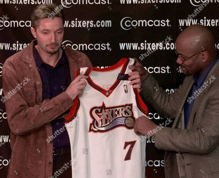 Stock Photo of KUKOC KING Philadelphia 76ers newly-acquired forward Toni Kukoc, left, is given his new team jersey by general manager Billy King during a news conference, in Philadelphia. Kukoc, formerly a member of the Chicago Bulls, was involved in a three-team trade Wednesday