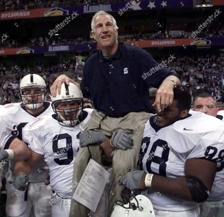 SANDUSKY Penn State defensive coordinator Jerry Sandusky is carried by players Rick Bolinsky (92) and Jason Wallace (88) after they defeated Texas A&M in the Alamo Bowl, Tuesday night, . Sandusky marks his 381st and final game as a member of Penn State's coaching staff