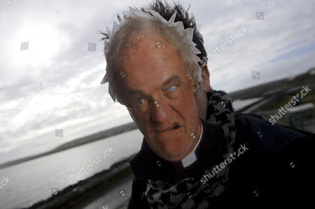A fan wearing a 'Father Jack' mask at the inaugural 'Father Ted' festival marking the ninth anniversary of the death of Dermot Morgan, the star of the series.