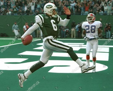 SMITH LUCAS New York Jets quarterback Ray Lucas (6) high steps into the endzone for a touchdown as Buffalo Bills cornerback Thomas Smith (28) looks on during the second quarter Sunday, Nov, 21, 1999, at Giants Stadium in East Rutherford, N.J. Lucas scored on a nine yard run as the Jets beat the Bills 17-7
