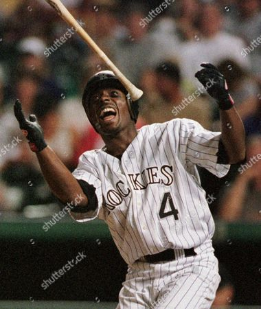 Stock Picture of JEFFREY HAMMONDS Colorado Rockies' Jeffrey Hammonds reacts by tossing his bat after swinging at and missing a pitch from Milwaukee Brewers' John Snyder in the third inning in Denver's Coors Field on . Hammonds walked on the at-bat