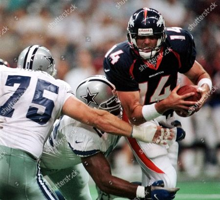 GRIESE NOBLE SIMMONS Denver Broncos quarterback Brian Griese (14) is sacked during the fourth quarter of play by Dallas Cowboys defenders Brandon Noble (75) and Sam Simmons (72) in Irving, Texas, . The Cowboys won the game 22-12