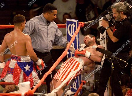 WEEKS Hector Camacho Jr., left, of Orlando, Fla., watches as Philip Holiday of South Africa falls through the ropes prior to referee Tony Weeks, second from left, stopping the fight in the sixth round of a super lightweight fight in Phoenix