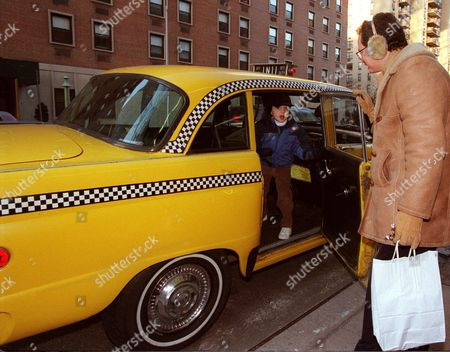 BELGOROD Barry Miles Belgorod, of New York, watches his son Gregory stand inside a 1978 Checker Cab Marathon four-door sedan, in New York. The 21 year-old cab, which has nearly one million miles on it and is reported to be the last Checker cab in service on the streets of New York, was sold for $134,500 to an unidentified phone bidder during an auction at Sotheby's
