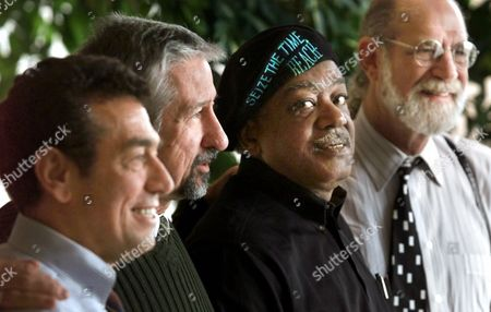 ROBERTS Defense team lawyers Gerald Lefcourt, left, and Dennis Roberts, right, join Chicago Seven defendants Tom Hayden and Bobby Seale, second from right, for a photo, in Chicago. The defendants and lawyers gathered during the fall conference of the National Association of Criminal Defense Lawyers to remember the 30th anniversary of the Chicago Seven trial