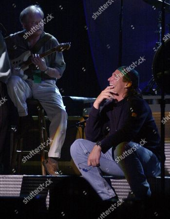 BILLY DEAN Country music singer Billy Dean, right, laughs at a friend's comment as he sits on the stage while waiting for his turn to perform during rehearsals for the Country Music Association Awards show on in Nashville, Tenn. The show will be held Wednesday, Oct. 4
