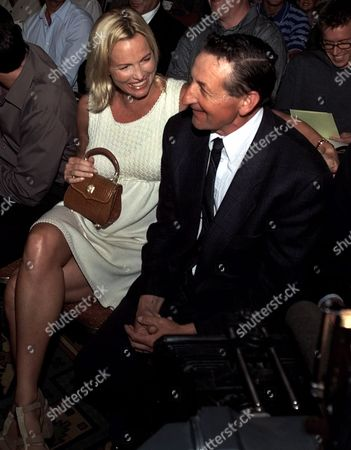 GRETZKY Janet Gretzky, wife of hockey great Wayne Gretzky, laughs with her father-in-law, Walter Gretzky, in Scottsdale, Ariz. The two were in attendance for the announcement of Wanye Gretzky's new position as the Phoenix Coyotes managing partner in charge of hockey operations