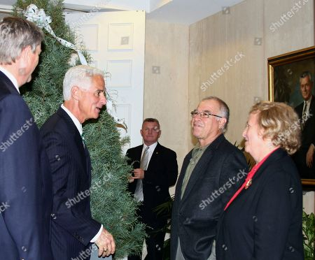 Stock Picture of Christmas Tree Florida Governor, Charlie Crist, second from left, thanks Christmas tree growers Franco and Sigrid Camacho of Tallahassee, Fla. after the couple presented a tree to be displayed at the entrance of Gov. Crist's office in Tallahassee, Fla. Wednesday Dec.1, 2010. To the left is state Agriculture Commissioner Charles Bronson