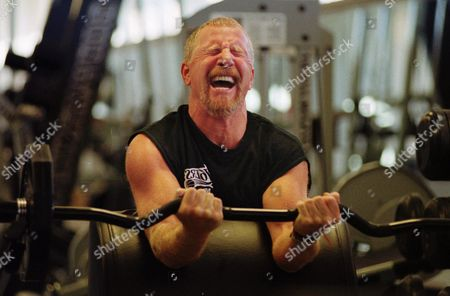 PAT CROCE Philadelpia 76ers owner Pat Croce grimaces as he finished the last repitition of one of his weight lifting workouts in Philadelphia. Croce is battling back after having his left leg nearly severed three months ago in a motorcycle accident