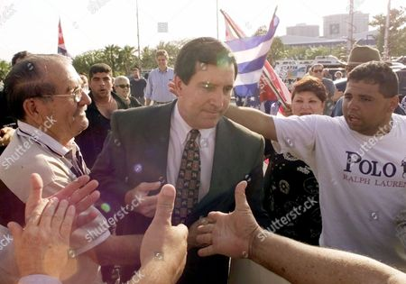 CAROLLO Miami Mayor Joe Carollo, center, makes his way through a crowd of Cuban-American supporters at the Miami City Hall in Miami. Carollo fired the city manager Thursday, just days after he demanded the man dismiss the police chief for failing to warn the mayor about the raid to seize Elian Gonzalez