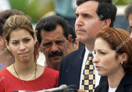 GONZALEZ ESTEFAN CAROLLO Gloria Estefan, right, speaks to the media gathered outside the home of Elian Gonzalez, . With her are Elian's cousin Marisleysis Gonzalez, left, great-uncle Lazaro Gonzalez, second from left, and Miami Mayor Joe Carollo