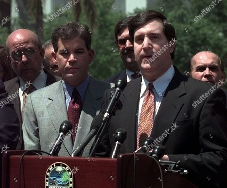 CAROLLO Miami Mayor Joe Carollo, right, addresses the media during a news conference regarding Elian Gonzalez in front of the Federal Courthouse in downtown Miami. Carollo was joined by 22 other Mayors from the Miami area proclaiming their support for keeping 6-year-old Elian in the United States