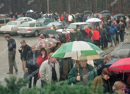 Stock Photo of Mourners line up for a memorial service for The Band bass player and lead singer Rick Danko in Woodstock, N.Y. . Danko died last Friday, a day after his 56th birthday. Hundreds of people stood in line in a cold misty rain this afternoon to attend his funeral which was being held in a theater
