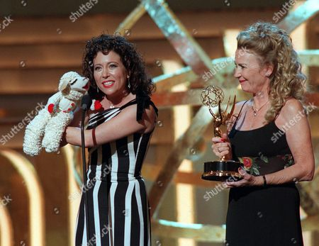 "MILLS Mallory Lewis, left, daughter of the late Shari Lewis, who was the original voice of ""Lamb Chop,"" joins Lamb Chop on stage to accept her mother's Daytime Emmy for Outstanding Performer in a Children's Series for ""Charlie Horse Music Pizza"" during the 27th Annual Daytime Emmy Awards at New York's Radio City Music Hall, . Juliet Mills holds the Daytime Emmy"