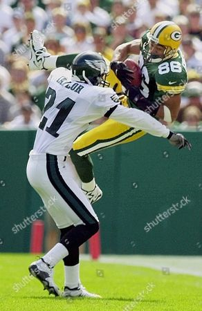 FREEMAN TAYLOR Green Bay Packers receiver Antonio Freeman (86) catches a pass in front of Philadelphia Eagles cornerback Bobby Taylor in the second quarter, in Green Bay, Wis