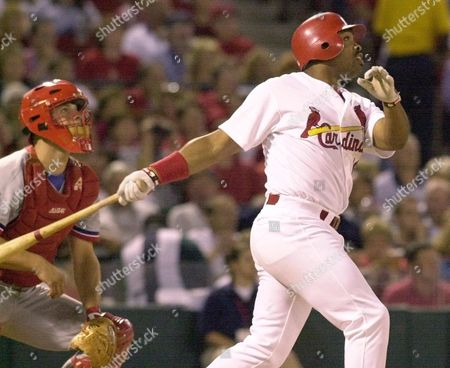 LANKFORD BARRETT St. Louis Cardinals' Ray Lankford follows the flight of his 21st home run of the year in the third inning against the Montreal Expos, at Busch Stadium in St. Louis. It was a two-run home run. Also watching in Expos catcher Michael Barrett